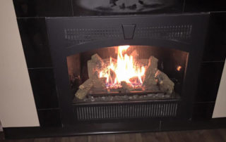 564HO high heat output gas fireplace with Black Wilmington face