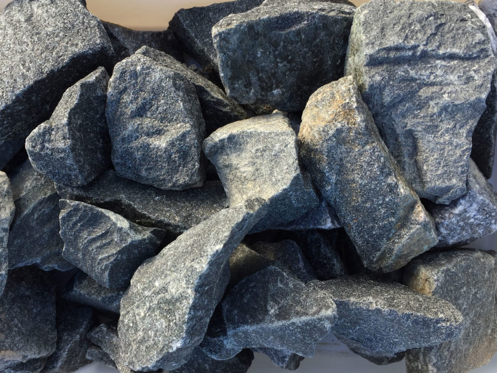 Landscaping zillges spa landscape fireplace for Landscaping rocks by the ton